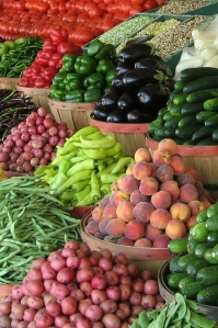 Farmers' Market stand with fruits and vegetables